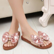 Summer women's casual wear flat flower slippers leather cowhide bow beach shoes handmade word big flower slippers shoes