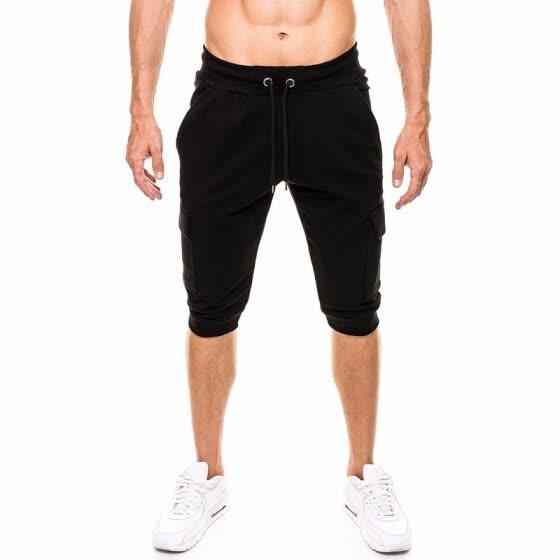 70fceb188afe Летние мужские моды повседневные шорты эластичные талии сплошной цвет  Открытый спортивные шорты молодежные пляжные брюки